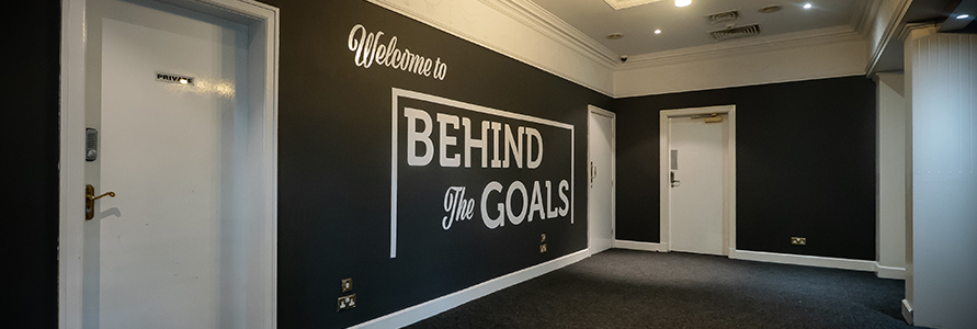 NEWLY REFURBISHED BEHIND THE GOALS OPEN FROM 12PM